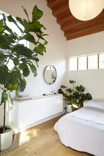 In the master bedroom, a clerestory window facilitates privacy and plenty of soft natural light.