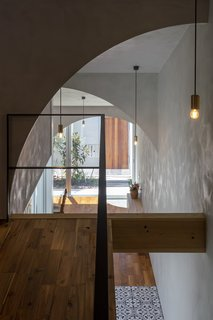 The home's numerous arches lend poetry, geometry, and a dynamic quality to the home as their soft curves frame various perspectives and provide a feeling of airiness.