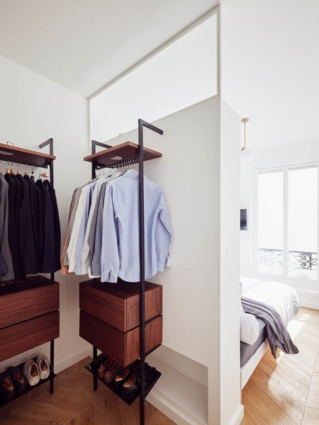 Petillaut designed a large closet on the other side of the partition wall, which also acts as a headboard for the bed, in one of the master bedrooms.