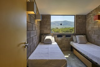 Twin beds flank a mountain view in one of the bedrooms.