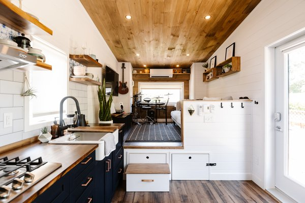 Ryan Tuttle's airy tiny home in the San Francisco Bay Area has distinct work areas and a surprising amount of storage space. She travels often for work as a photographer, so the non-traditional, downsized living arrangement is perfectly suited for her and her dog. Since her tiny home is titled with the DMV as an RV, and not a permitted structure with a foundation, she has to keep a low profile so as not to attract the attention of whistleblowers.