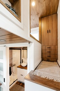 A wardrobe is nestled at the top of the stairs.