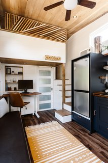Ryan designed a small office nook tucked under the loft-style bedroom.