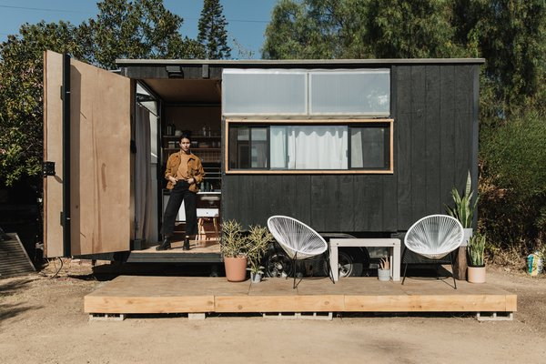Mariah Hoffman stands in the doorway of the 156-square-foot home she designed and built for herself.