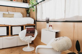 The built-in dining table folds down to create more open space in the tiny home.