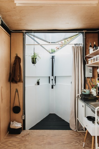 """To create a stronger outdoor connection and sense of loftiness, Hoffman built a skylight over the bathroom. """"I'd always wanted an outdoor shower,"""" she says."""
