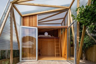 A Wellington, New Zealand, couple loved their neighborhood of Berhampore, but found that with two young sons, they were running out of space. They called on Parsonson Architects to devise a solution, which came in the form of a 183-square-foot studio in the backyard of their two-bedroom Victorian cottage.
