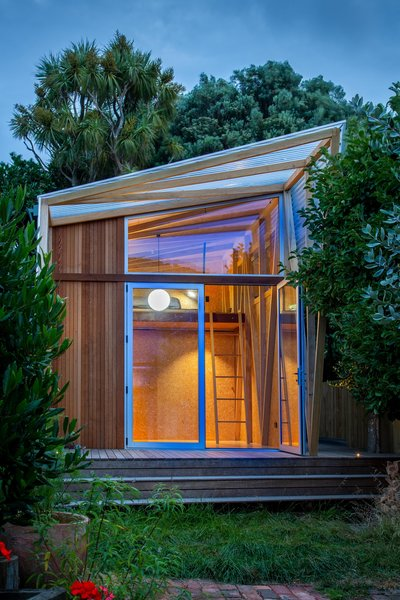 The backyard studio that architect Gerald Parsonson designed to expand a young family's living space features a wraparound deck that connects the hideaway to the garden.