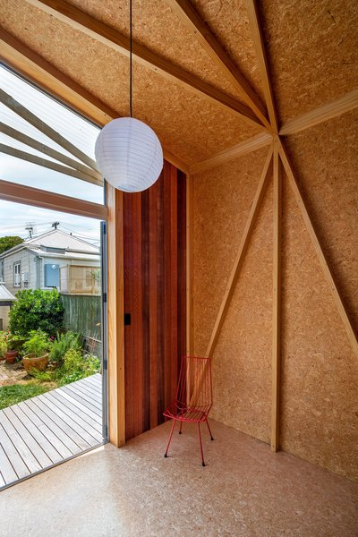 Parsonson outfitted the interior walls, floor, and ceiling with oriented strand board (OSB). Structural supports form triangles, creating an artful, geometric aesthetic.