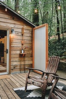 The large wood deck features an outdoor shower that helps to provide an indoor/outdoor living experience.