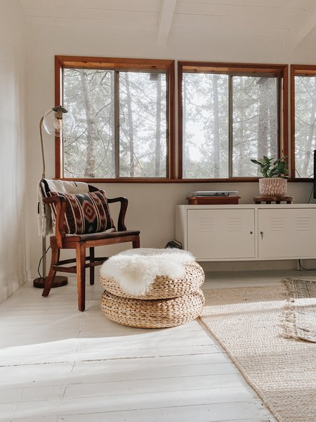 Hope arranged the living room with a woven ottoman and rug that lend warmth and texture.