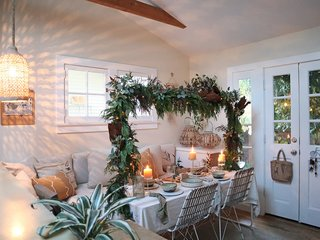 The living room converts to a dining room on special occasions.