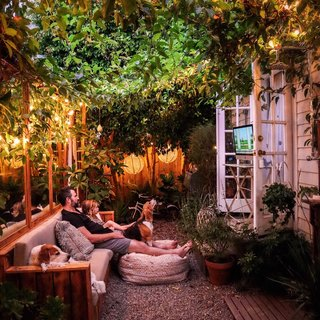 If you already have a projector, white sheets and some popcorn are all you need to create your own outdoor cinema. Alternatively, you can set up a backyard screening with a monitor, TV stand, and an extension cord.