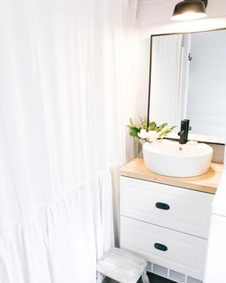 The bathroom accommodates a full-size tub and a clothes washer and dryer.