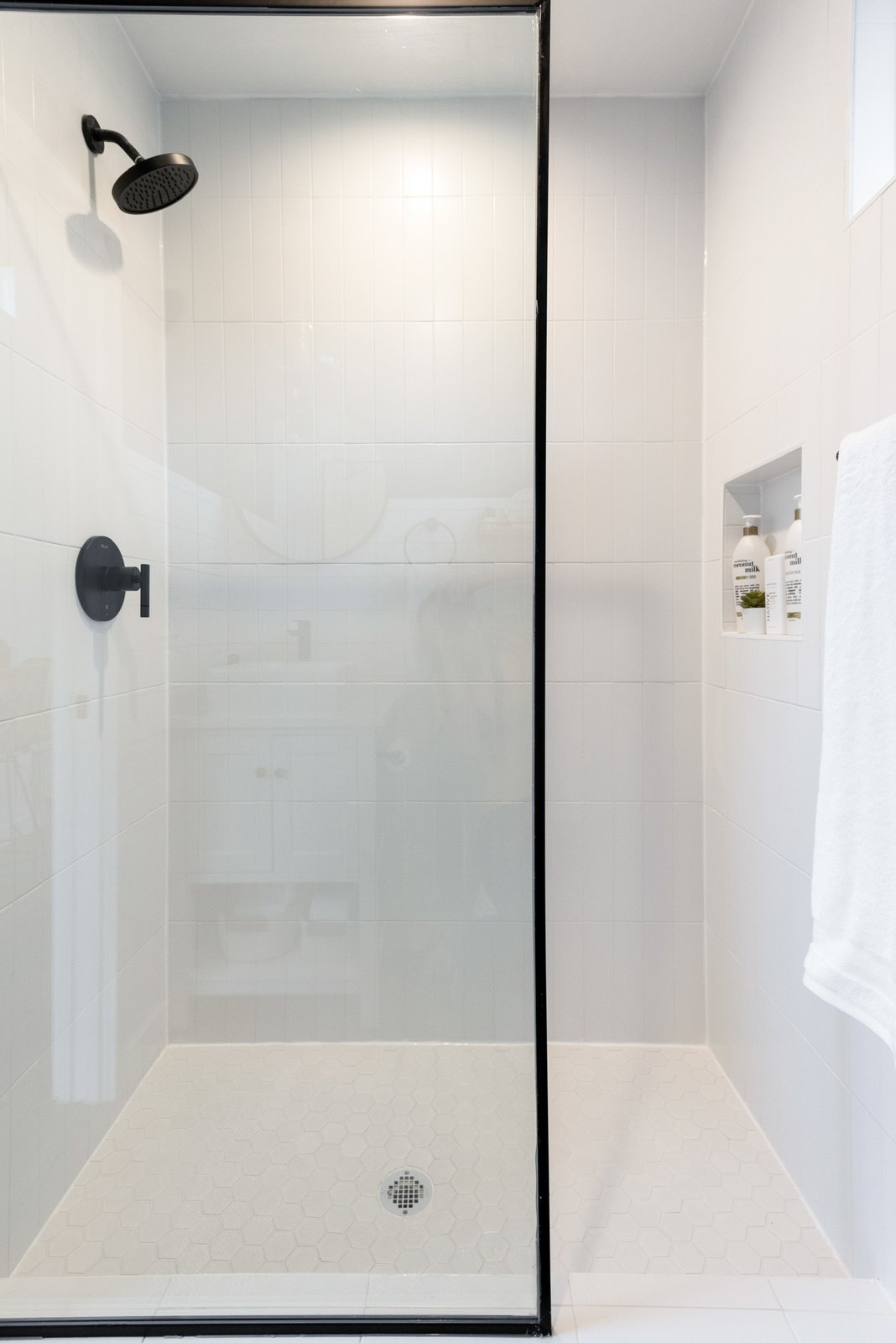 Bath Room, Full Shower, Open Shower, and Porcelain Tile Wall Like the kitchen and the bedroom, the bath is outfitted in a palette of gray and white.   Photo 10 of 10 in An Austin Couple Build a 200-Square-Foot Office and Guesthouse in Their Backyard