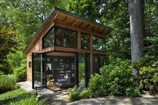 Virginia-based screenwriter Matthew Michael Carnahan's 400-square foot work studio features NanaWall doors that fold open to connect the interior to the surrounding forest.