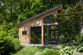 The cedar cladding was inspired by the towering mature oaks on the property.