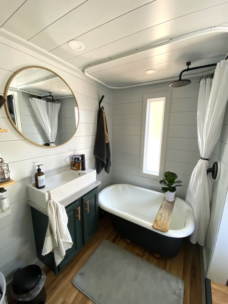 Saul outfitted an antique, cast-iron clawfoot tub ($200) with a rainfall showerhead ($80) in the bathroom.