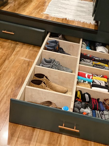 Sizable drawers beneath the kitchen floor store the couple's clothing and shoes.