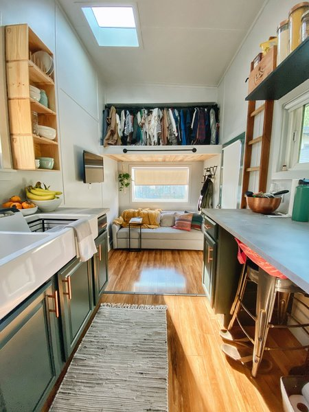 For now, the second sleeping loft functions as a closet.