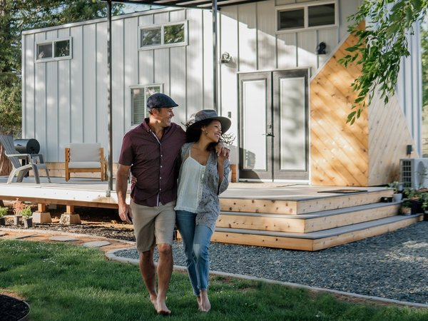 Tony and Charlotte Perez designed and built their own 280-square-foot home, which features an expansive deck off of the front facade.