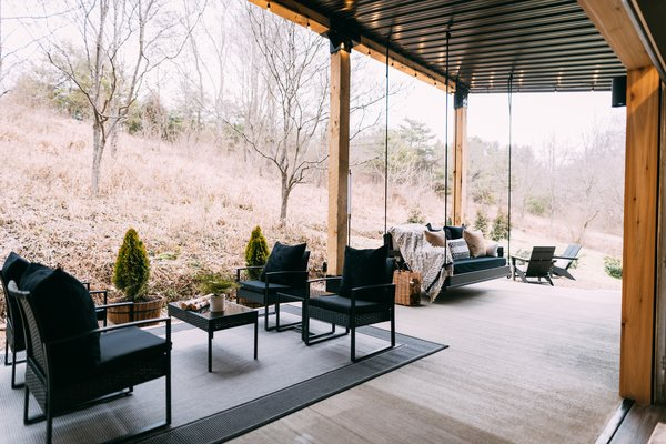 The home features 200 square feet of outdoor living space that includes a bed swing, a fire pit area, a hot tub and a large gas grill.