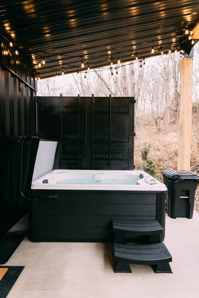 Troy and Dianna Shurtz used the doors of the shipping container to create a screen that offers privacy for the hot tub.