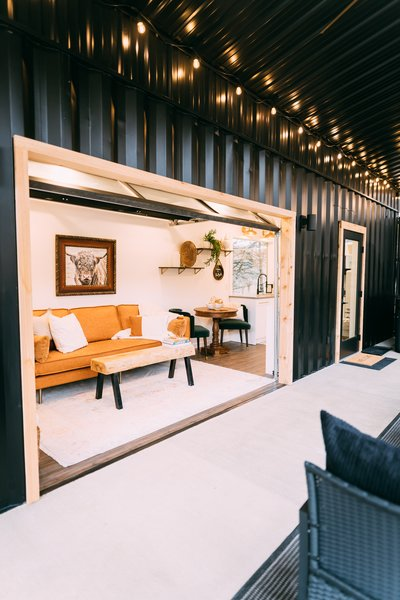 When the roll-up garage-style door is open, the living room links to the porch, creating an indoor/outdoor living experience.