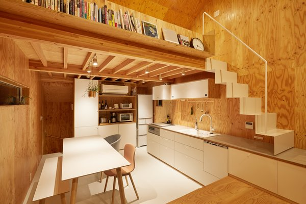 Sasaki placed an open-plan kitchen, dining area and living space on the second level; a flexible loft space is situated above the kitchen.