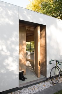 """""""The main and side entrance doors were handmade using the same plywood we used for the interior walls,"""" Adam says."""