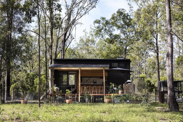 The 304-square-foot house in Queensland, Australia, is clad with steel and cedar—materials that help the home meld with the wooded landscape.