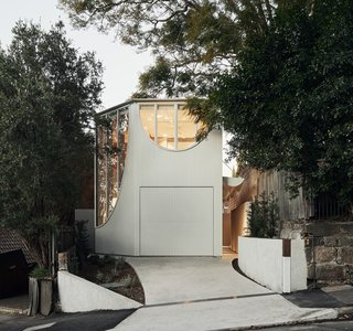 The Glebe House by Chenchow Little architects is defined by its arched windows and wedge-like form.