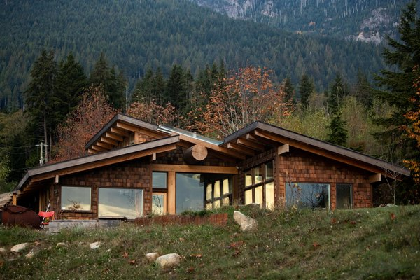 The home that Marlin Hanson, of Hanson Land & Sea, built for his family is clad with cedar shingles and features a green roof and a massive Douglas fir support beam that runs from the interior to the exterior.