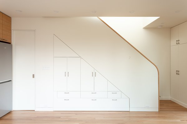 Built-in cabinetry beneath the staircase provides extra storage space for the 1,024-square-foot home.