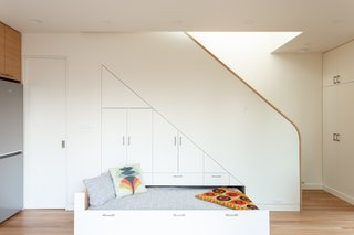 As part of the built-in cabinetry beneath the stairs, Wilson included a pull-out bed that can be used by overnight guests.