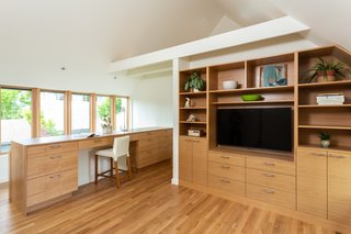The second level showcases built-in cabinetry and an office area crafted from cedar.