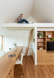 A sleeping loft above the second-level office accommodates sleepovers with visiting grandchildren.