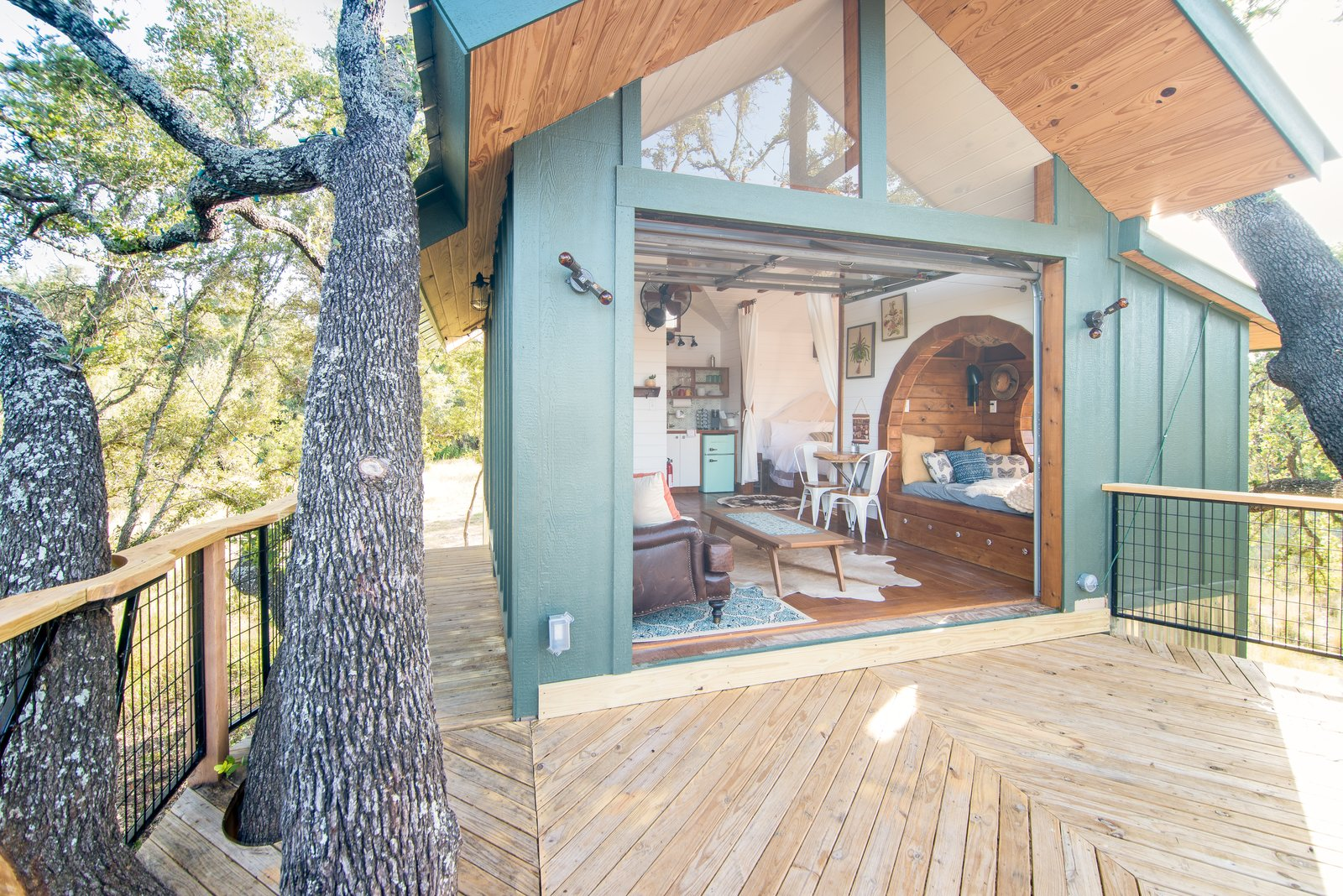 Exterior, Treehouse Building Type, Wood Siding Material, and Gable RoofLine The Live Oak is one of three playful tree houses available to rent at HoneyTree Farm in Fredericksburg, Texas.  Photo 1 of 10 in Book a Stay in This Whimsical Trio of Tiny Tree Houses