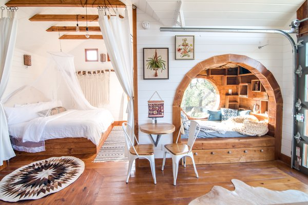 A wood-clad book nook and pine beams and flooring lend warmth and texture in The Live Oak tree house.