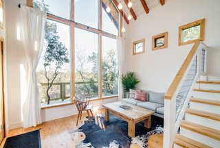 A window wall connects the living area of The Sycamore to the outdoors.