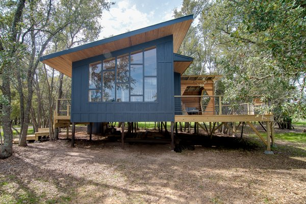 The Sapling is clad with board-and-batten and features a gazebo with a hexagonal opening on the rear deck.