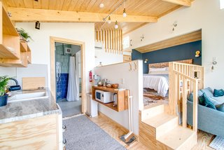 The elevated bedroom in The Sapling accesses a loft area.