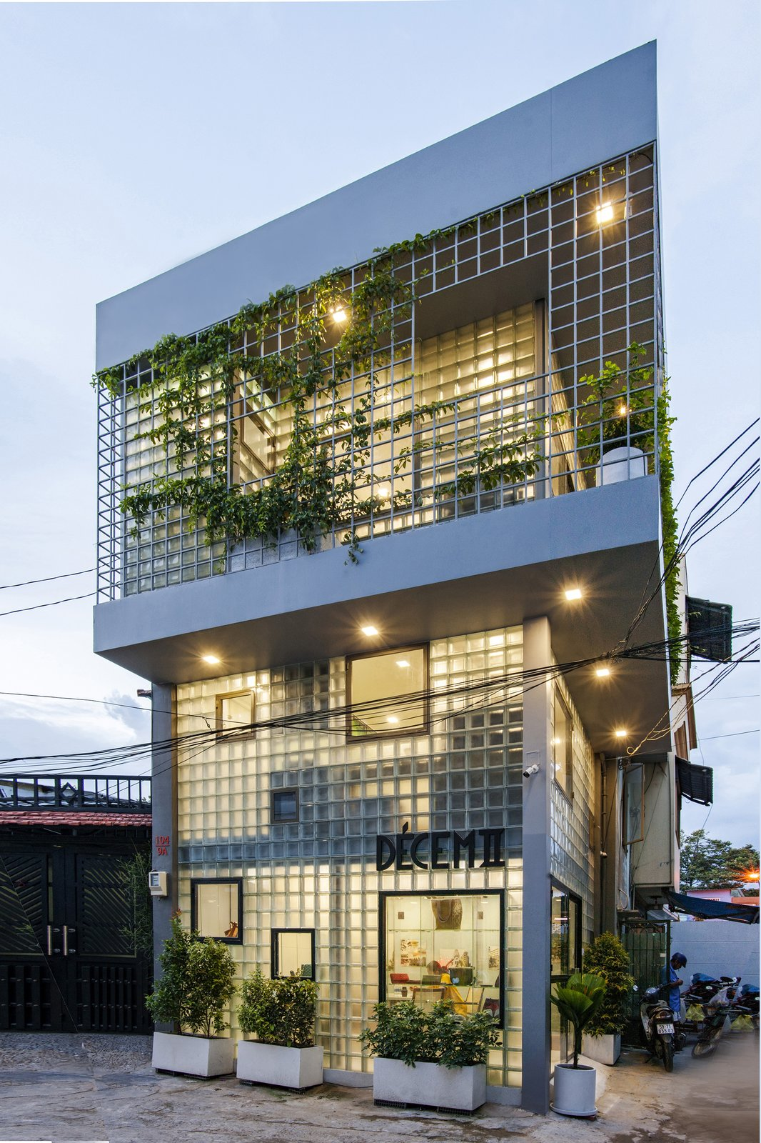 In the evening, the glass-block home and boutique display a lantern-like quality.  Photo 3 of 12 in This Vietnamese Micro Home Is as Practical as It Is Radiant