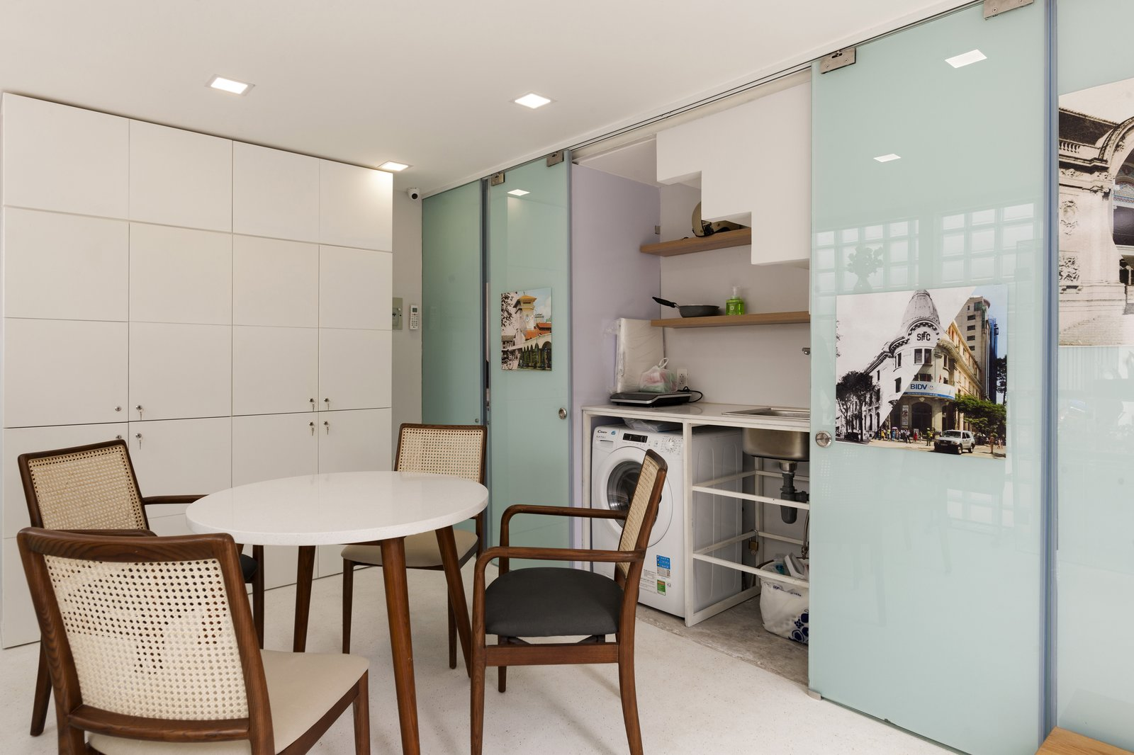 Dining Room, Chair, Recessed Lighting, and Table The kitchen, dining space and laundry area are also located on the ground level.  Photo 5 of 12 in This Vietnamese Micro Home Is as Practical as It Is Radiant