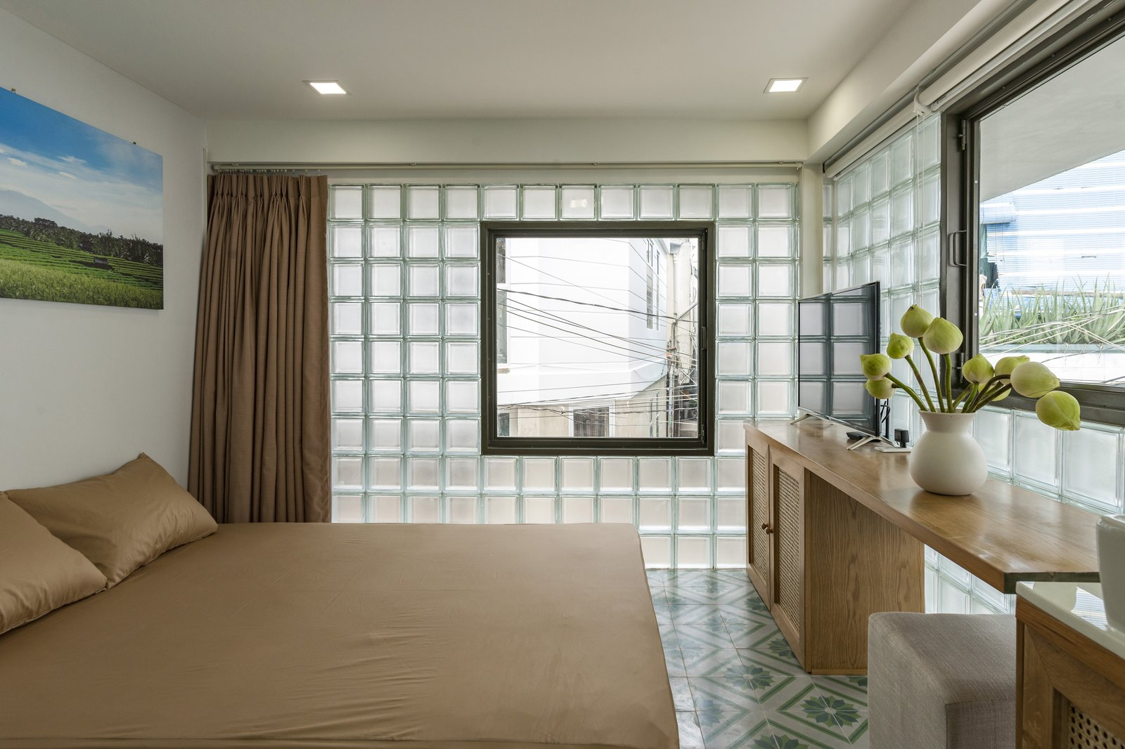 Bedroom, Bed, Recessed Lighting, Ceramic Tile Floor, and Porcelain Tile Floor The guest bedroom and bath are located on the second level of the home.  Photo 6 of 12 in This Vietnamese Micro Home Is as Practical as It Is Radiant