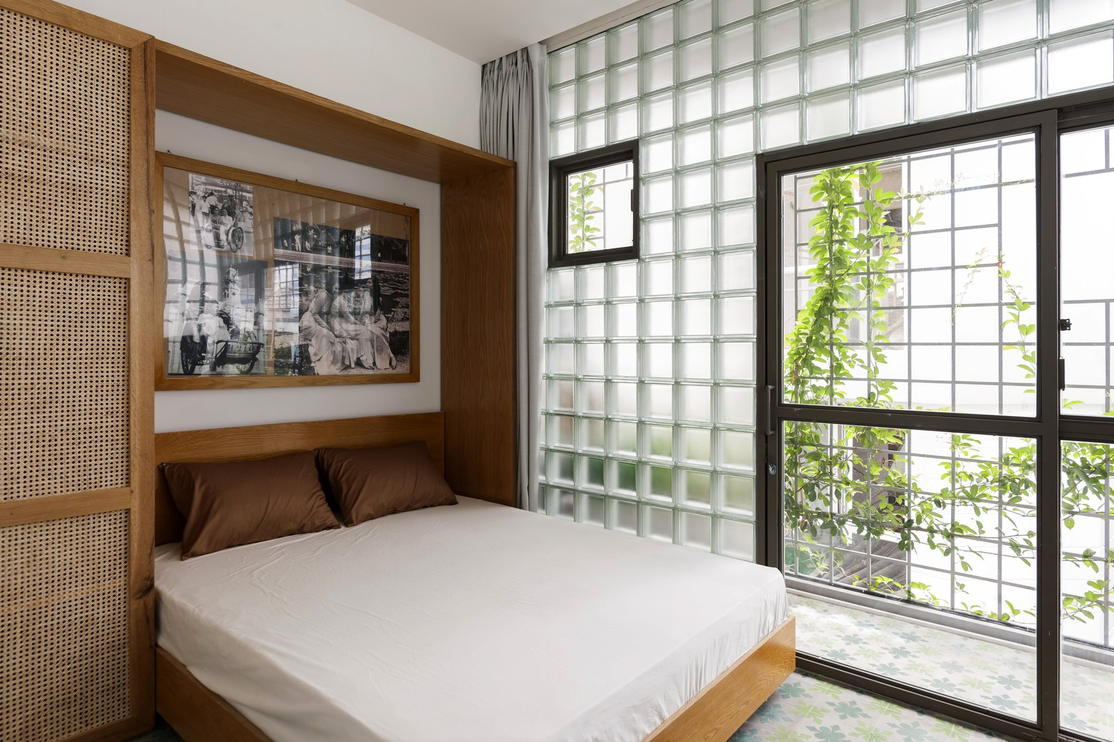 Bedroom, Bed, Porcelain Tile, and Ceramic Tile The glass-block  Bedroom Bed Porcelain Tile Photos from This Vietnamese Micro Home Is as Practical as It Is Radiant