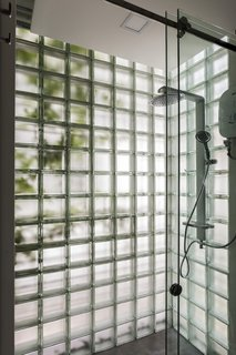 A glass-block shower in the master supplies the feeling of being outdoors.