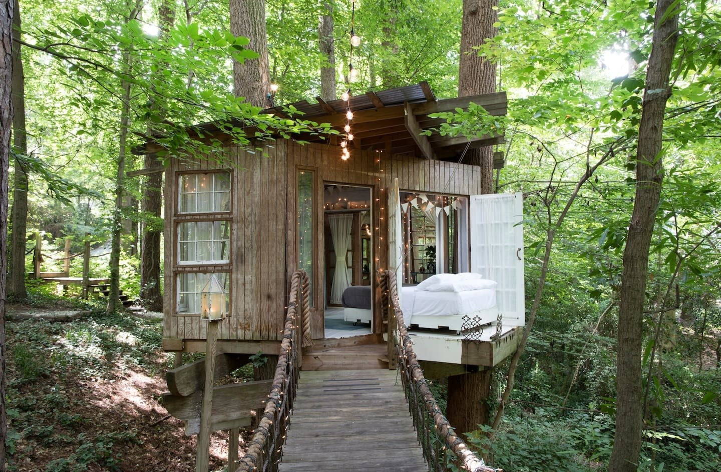 The treehouse consists of 3 separate areas, mind, body and spirit, that are connected by rope-bridges. Courtesy of Airbnb  Photo 2 of 24 in Check Out These 23 Tiny Houses Perfect for an Autumn Getaway
