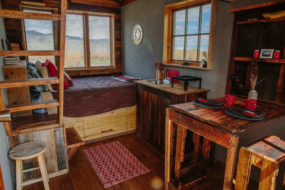 The Wagon showcases cinematic vistas and a cabin-like interior with wood furnishings.  Photo 4 of 24 in Check Out These 23 Tiny Houses Perfect for an Autumn Getaway