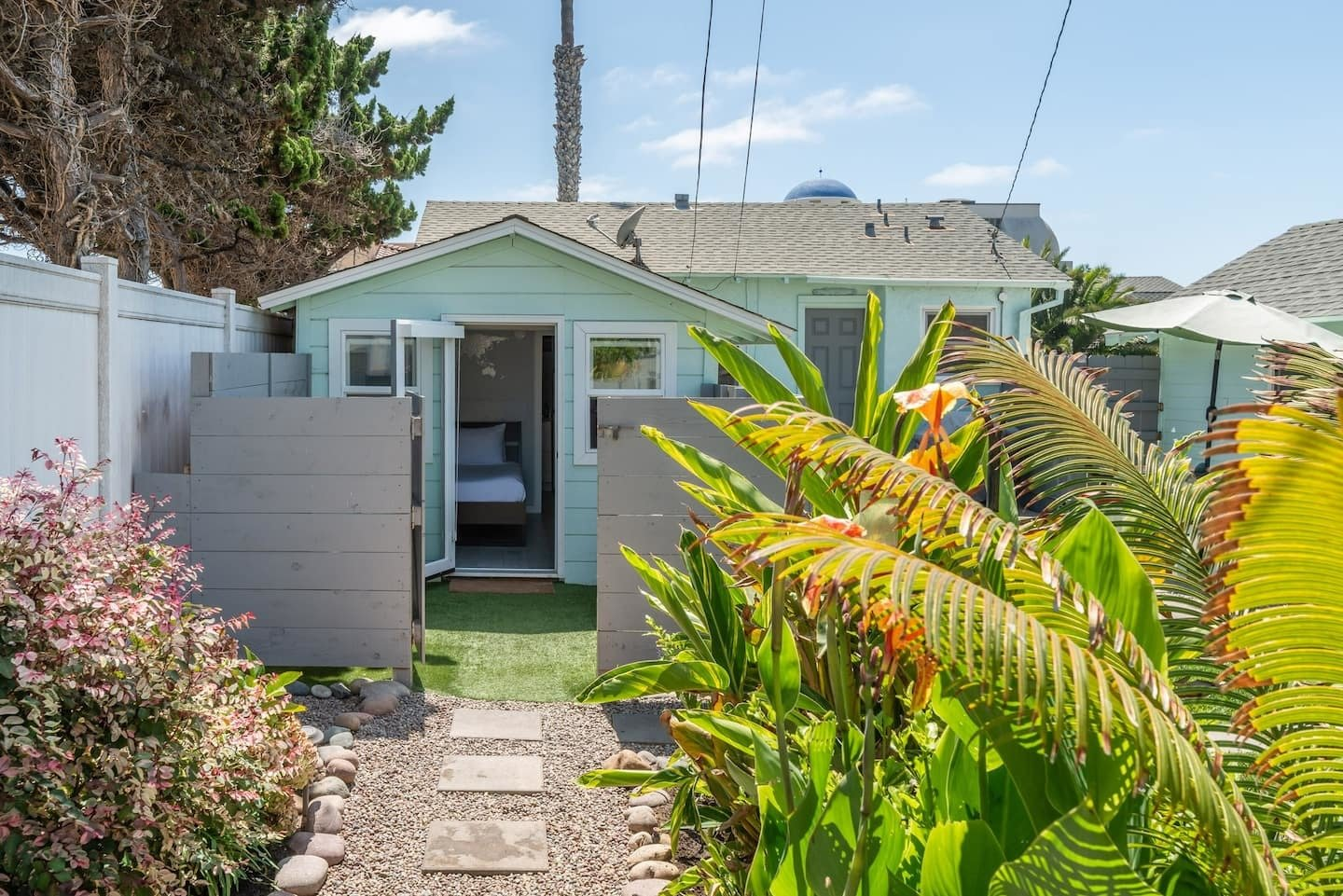 The bungalow and tiny guesthouse's mint-green exterior creates a feeling of calm.  Photo 7 of 24 in Check Out These 23 Tiny Houses Perfect for an Autumn Getaway